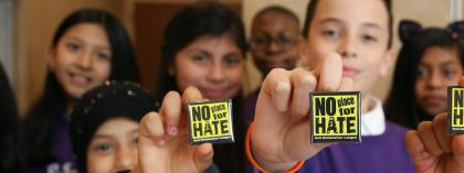 Students holding up no place for hate pins