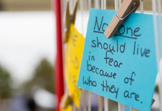 Post-it note that says: No one should live in fear because of who they are.